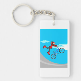 Young BMX giving a great jump with its bicycle Key Ring