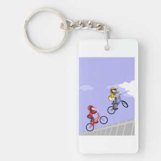 Young BMX giving its better jump with its bicycles Key Ring