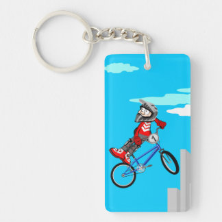 Young BMX jumping in the air with its bicycle Key Ring