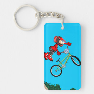 Young BMX jumps by the air and makes a pirouette Key Ring