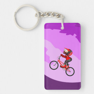 Young BMX with its bicycle raising the hill Key Ring