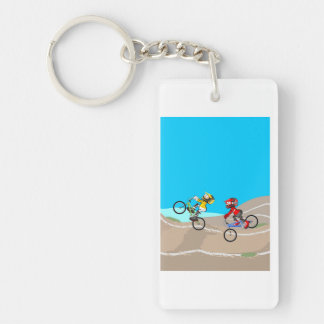 Young BMX with their bicycles compete in the track Key Ring