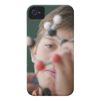 Young boy holding DNA model iPhone 4 Case