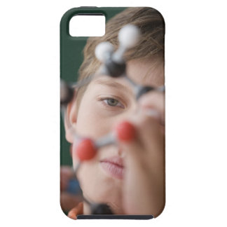 Young boy holding DNA model iPhone 5 Cover