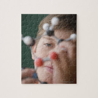 Young boy holding DNA model Puzzle