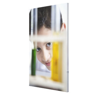 Young boy in chemistry science class, looking canvas print