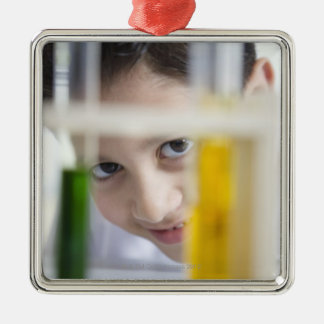 Young boy in chemistry science class, looking Silver-Colored square decoration