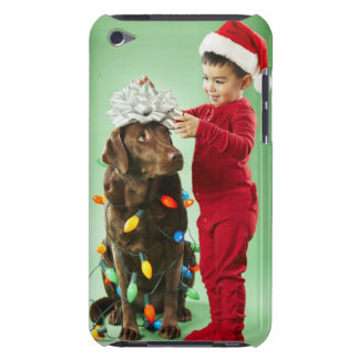 Young boy wrapping Christmas lights around a dog Case-Mate iPod Touch Case