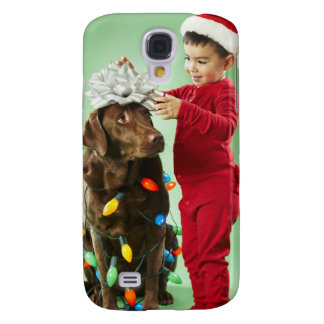 Young boy wrapping Christmas lights around a dog Galaxy S4 Case