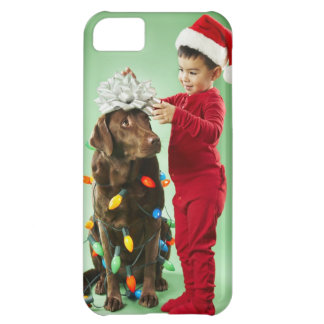 Young boy wrapping Christmas lights around a dog iPhone 5C Case
