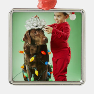 Young boy wrapping Christmas lights around a dog Silver-Colored Square Decoration