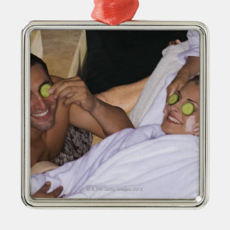 Young couple enjoying a spa treatment. christmas ornament