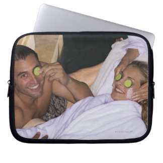 Young couple enjoying a spa treatment. laptop sleeve