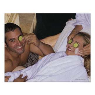 Young couple enjoying a spa treatment. poster
