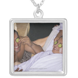 Young couple enjoying a spa treatment. silver plated necklace