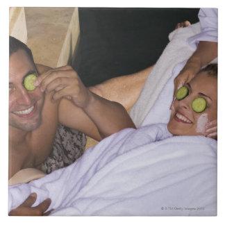 Young couple enjoying a spa treatment. tile