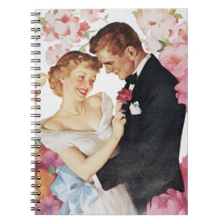 Young couple in formal wear notebooks