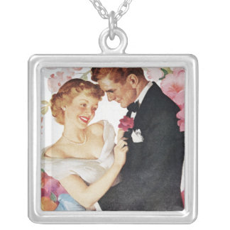 Young couple in formal wear silver plated necklace