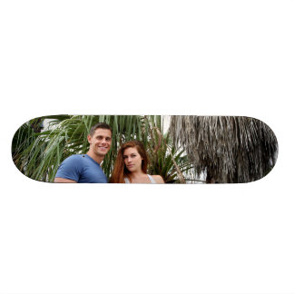 Young Couple Palm Tree Skate Boards