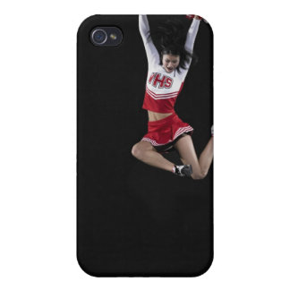 Young female cheerleader jumping in midair, arms 2 iPhone 4/4S cases