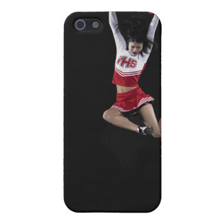 Young female cheerleader jumping in midair, arms 2 iPhone 5/5S cases