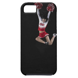 Young female cheerleader jumping in midair, arms 2 iPhone 5 covers