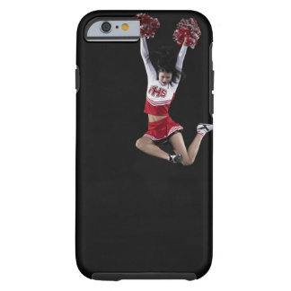 Young female cheerleader jumping in midair, arms 2 tough iPhone 6 case