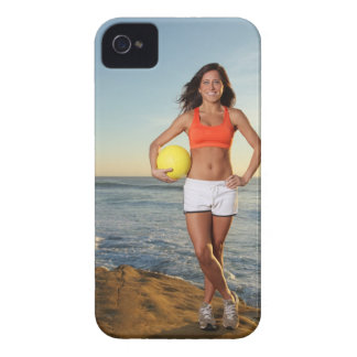 young fit pretty female holding a volleyball at iPhone 4 Case-Mate cases