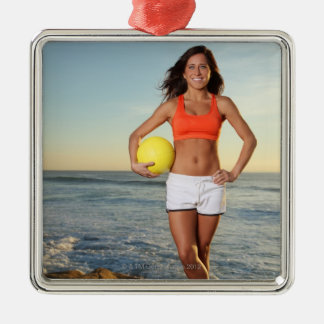 young fit pretty female holding a volleyball at Silver-Colored square decoration