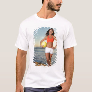 young fit pretty female holding a volleyball at T-Shirt