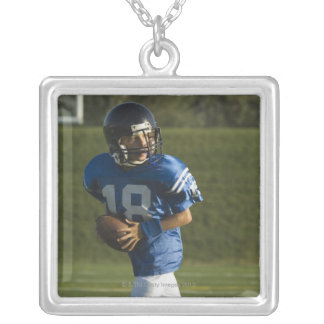 Young football player running with ball square pendant necklace