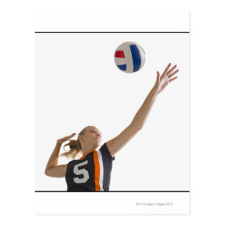 Young girl (16-17) playing volleyball postcard