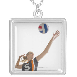 Young girl (16-17) playing volleyball silver plated necklace