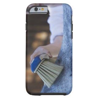 young girl brushing white horse tough iPhone 6 case