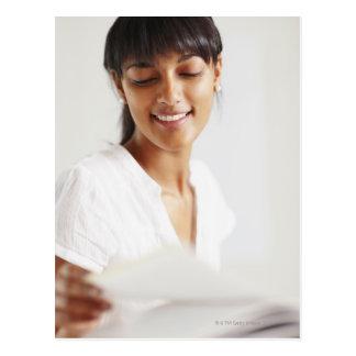 Young girl doing homework postcard