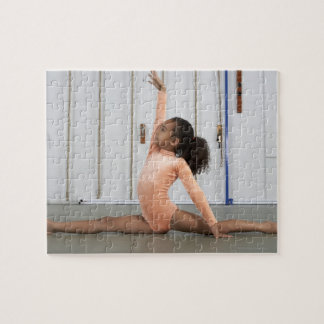 Young girl gymnast practicing her floor jigsaw puzzle