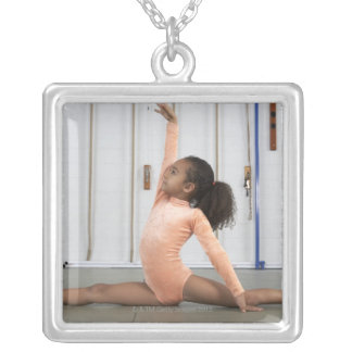 Young girl gymnast practicing her floor silver plated necklace