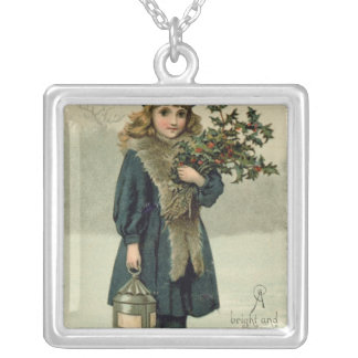 Young girl with Holly and Lantern Silver Plated Necklace