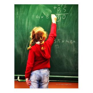 young girl writing on a blackboard postcard