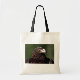 Young golden eagle tote bags