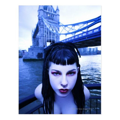Young Goth woman leaning suggestively near Tower Postcards