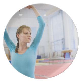 Young gymnast posing plates