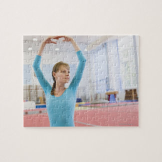 Young gymnast posing puzzles