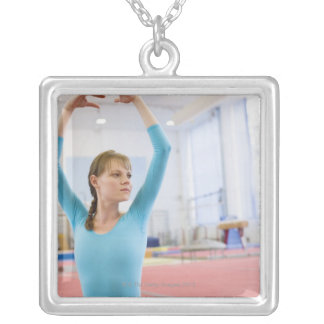 Young gymnast posing silver plated necklace