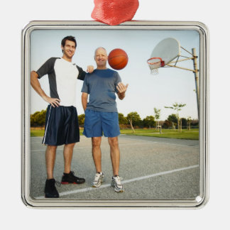Young man and senior man on outdoor basketball Silver-Colored square decoration