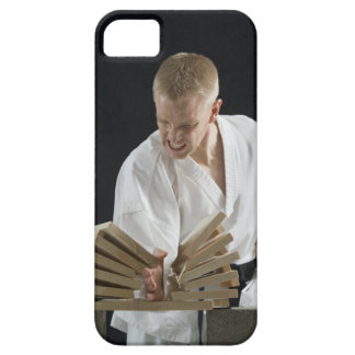 Young man breaking boards with karate chop on barely there iPhone 5 case