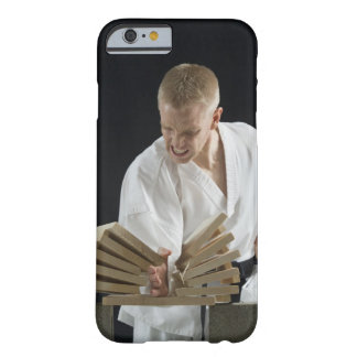 Young man breaking boards with karate chop on barely there iPhone 6 case