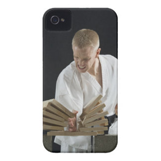 Young man breaking boards with karate chop on iPhone 4 Case-Mate case