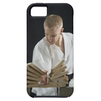 Young man breaking boards with karate chop on iPhone 5 cover