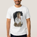 Young man breaking boards with karate chop on shirts